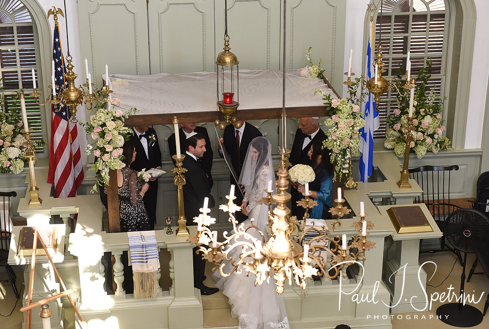 A look at Helen and Mike during their September 2018 wedding ceremony at the Touro Synagogue in Newport, Rhode Island.