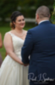 Ashley looks at Adam during her September 2018 wedding ceremony at Stepping Stone Ranch in West Greenwich, Rhode Island.