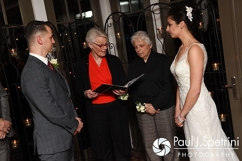 Gina and David listen to their officiant during their December 2016 wedding ceremony at the Waterman Grille in Providence, Rhode Island.
