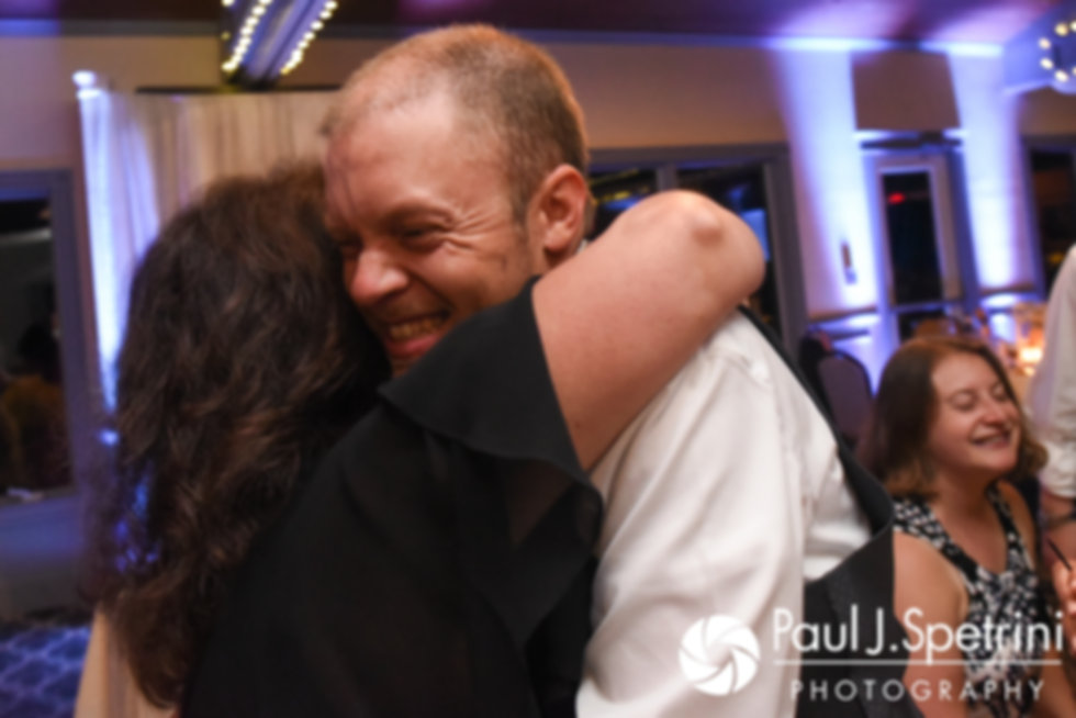 Scott hugs a guest during his August 2017 wedding reception at Crystal Lake Golf Club in Mapleville, Rhode Island.