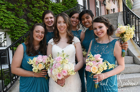 Sarah smiles for a photo with her bridesmaids following her June 2018 wedding ceremony at the College of the Holy Cross in Worcester, Massachusetts.