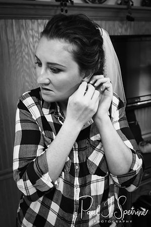 Allie puts her earrings in prior to her October 2018 wedding ceremony at South Ferry Church in Narragansett, Rhode Island.