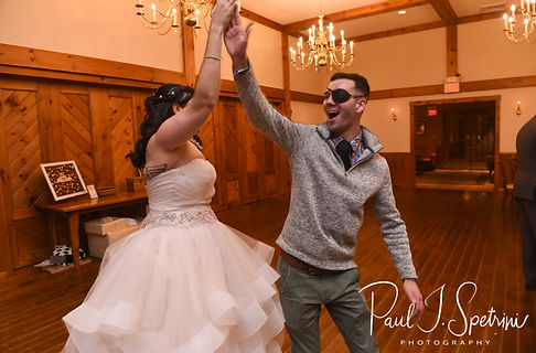 Makayla high fives a guest during her October 2018 wedding wedding reception at Zukas Hilltop Barn in Spencer, Massachusetts.