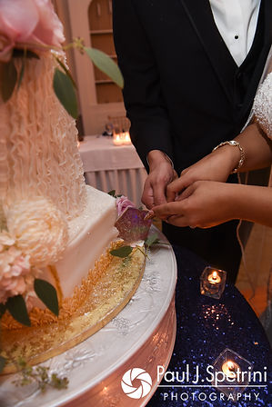 Arten and Stephany cut the cake during their September 2017 wedding reception at Wannamoisett Country Club in Rumford, Rhode Island.