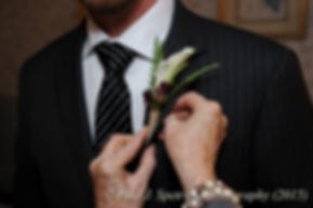 Mike has his flower adjusted prior to his November 2015 wedding at the Publick House in Sturbridge, Massachusetts.