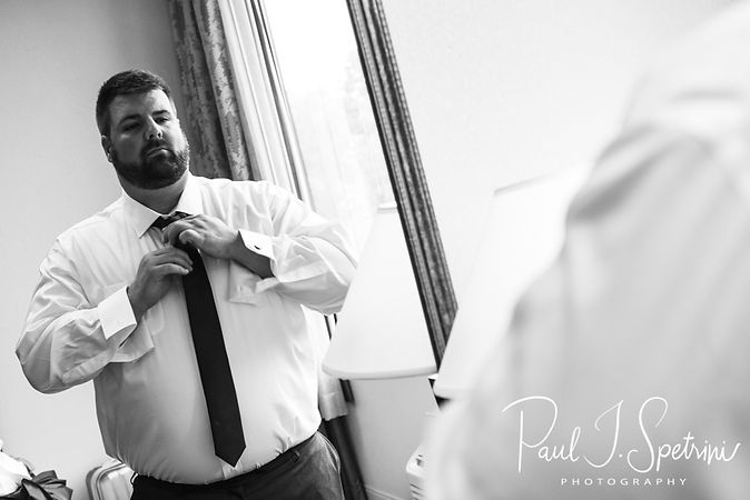Steve fixes his tie prior to his October 2018 wedding ceremony at The Villa at Ridder Country Club in East Bridgewater, Massachusetts.