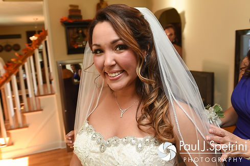 Stephanie smiles for a photo prior to her October 2016 wedding ceremony at the Historic St. Joseph Church in Cumberland, Rhode Island.