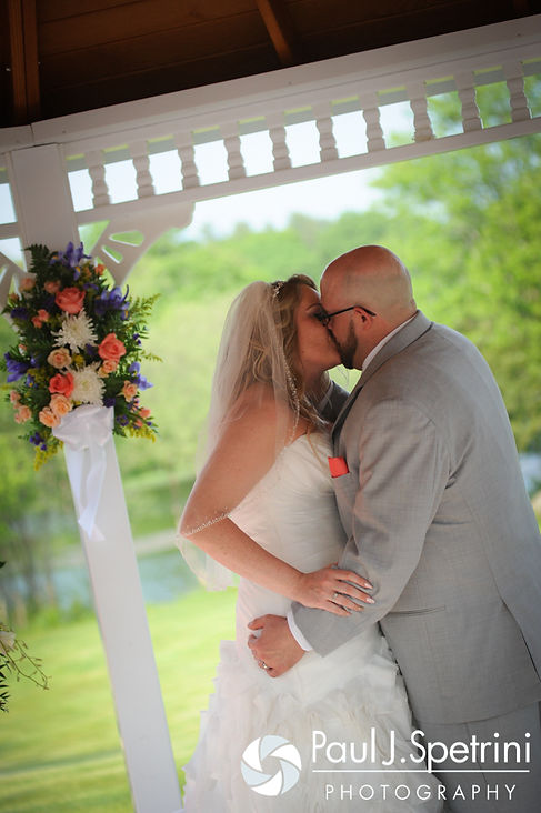 Michelle and Eric share their first kiss during their May 2016 wedding at Hillside Country Club in Rehoboth, Massachusetts.