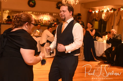 Gunnar and his mother dance during his December 2018 wedding reception at McGoverns on the Water in Fall River, Massachusetts.