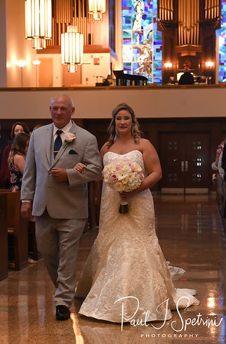Sarah walks down the aisle during her October 2018 wedding ceremony at St. Augustine Catholic Church in Providence, Rhode island.