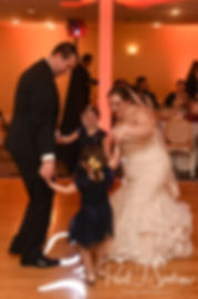 Chris and Stephanni dance with a guest during their October 2018 wedding reception at Rachel's Lakeside in Dartmouth, Massachusetts.