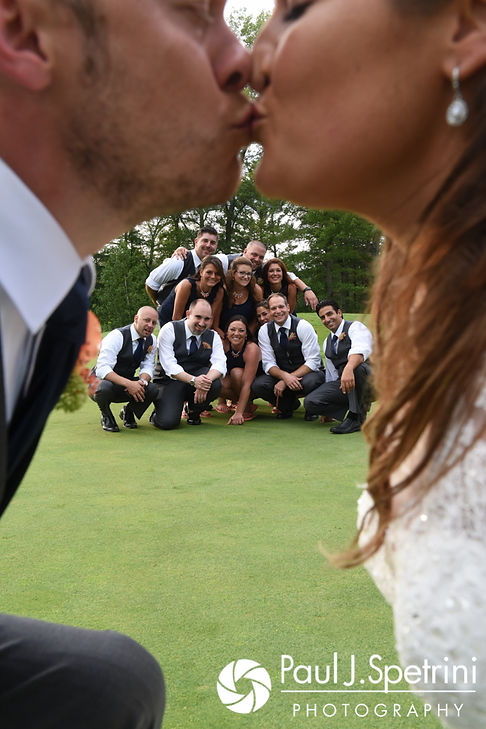 Toni and Scott kiss during a photo following their August 2017 wedding ceremony at Crystal Lake Golf Club in Mapleville, Rhode Island.