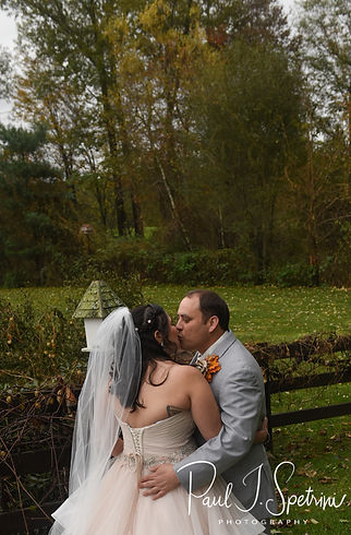 Rich and Makayla share a kiss prior to their October 2018 wedding ceremony at Zukas Hilltop Barn in Spencer, Massachusetts.