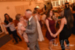 Guests dance during Amber & Justin's June 2018 wedding reception at North Beach Clubhouse in Narragansett, Rhode Island.