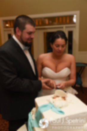 Kelly and Brian cut their wedding cake during their November 2016 wedding reception at the Bay Pointe Club in Buzzards Bay, Massachusetts.