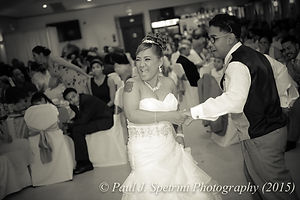 Jean Andrade dances with her son at her wedding.