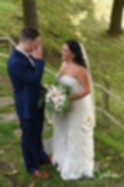 Michael and Miranda share a first look prior to their August 2018 wedding ceremony at the Squantum Association in Riverside, Rhode Island.