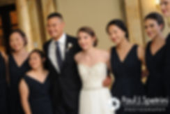 Dan and Simonne pose for a photo with the bridesmaids during their June 2016 wedding in Providence, Rhode Island.