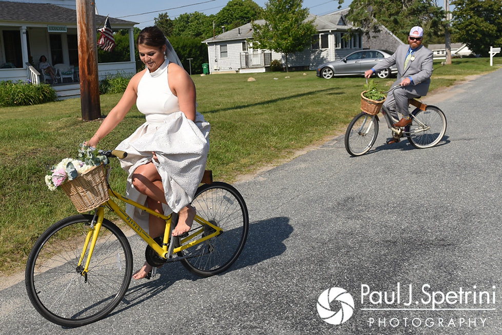 Molly and Tim ride away from the church following their June 2017 wedding ceremony at Saint Romuald Chapel in Matunuck, Rhode Island.