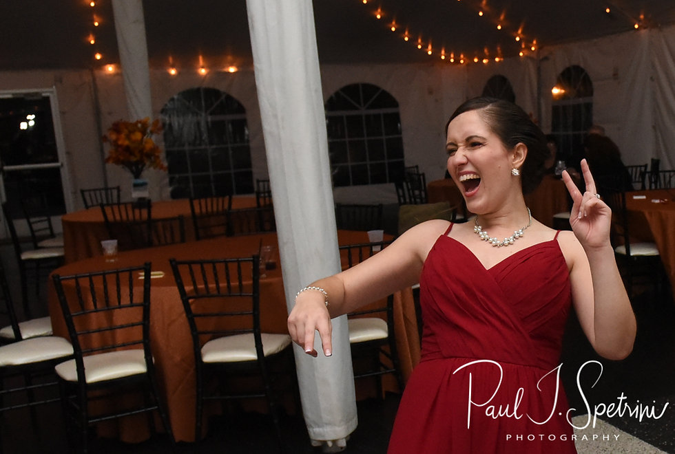 A bridesmaid laughs during Rich & Makayla''s October 2018 wedding wedding reception at Zukas Hilltop Barn in Spencer, Massachusetts.