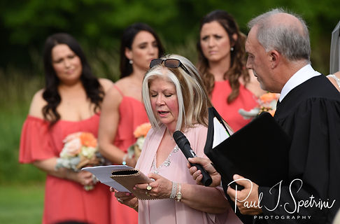 A family member reads a passage during Jacob & Stephanie's June 2018 wedding ceremony at Foster Country Club in Foster, Rhode Island.