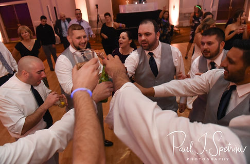 Anthony shares a drink with his groomsmen during her October 2018 wedding reception at The Omni Hotel in Providence, Rhode Island.