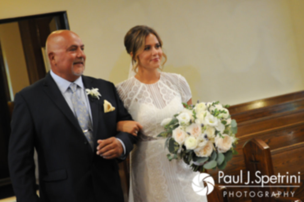 Jennifer and her father walk down the aisle during her August 2017 wedding ceremony at St. Joseph Church in New London, Connecticut.
