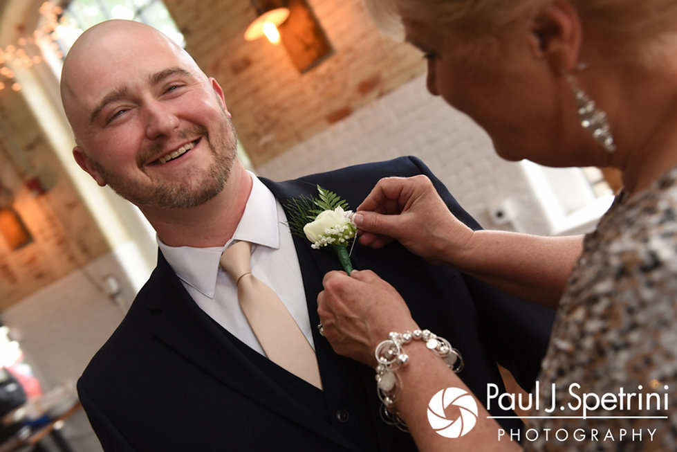 Matthew smiles as his mother applies his boutonniere prior to his May 2017 wedding ceremony at the Hope Artiste Village in Pawtucket, Rhode Island.