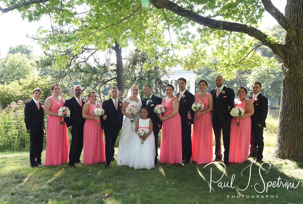Courtney and Patrick pose for a photo with their wedding party at Roger Williams Park in Providence, Rhode Island following their September 2018 wedding at St. Paul Church in Cranston, Rhode Island.