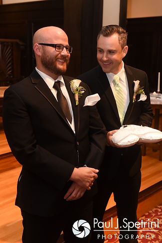 Forrester smiles as he waits for Lisajean to arrive during his October 2016 wedding ceremony at St. Thomas More Church in Narragansett, Rhode Island.
