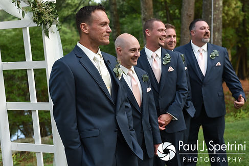 Matt waits for Kim to walk down the aisle during their August 2016 wedding at Whispering Pines Conference Center in West Greenwich, Rhode Island.