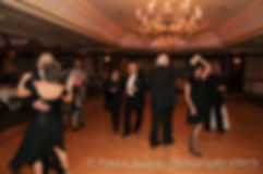 Guests dance during Cathy and Ron's December 2015 Rhode Island wedding at Quidnessett Country Club in North Kingstown, RI.