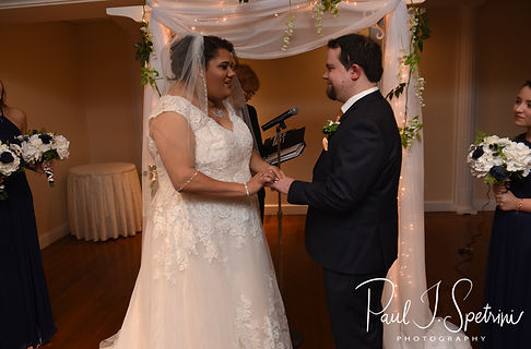 Gunnar and Aileen exchange rings during their December 2018 wedding ceremony at McGoverns on the Water in Fall River, Massachusetts.