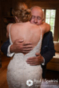 Kim and her father share a hug prior to her August 2016 wedding at Whispering Pines Conference Center in West Greenwich, Rhode Island.