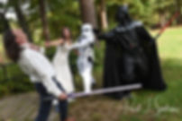 Amanda & Josh pose for a formal photo with Darth Vader and a Stormtrooper during their October 2018 wedding reception at Loon Pond Lodge in Lakeville, Massachusetts.