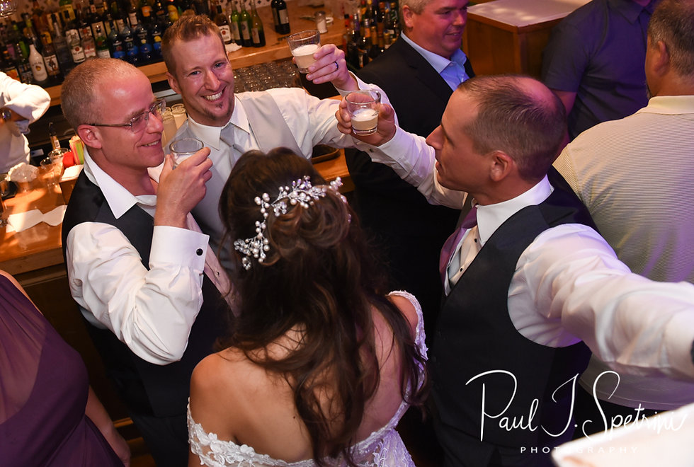 Beth and Bryan drink with guests during their August 2018 wedding reception at McGovern's on the Water in Fall River, Massachusetts.