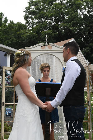 Kim and Josh listen to their officiant during their September2018 wedding ceremony at their home in Coventry, Rhode Island.