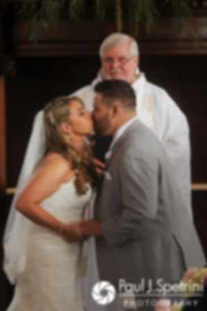 Nathan and Amy kiss during their November 2017 wedding ceremony at First Unitarian Church of Providence in Providence, Rhode Island.