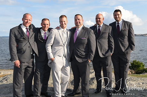 Bryan pose for a formal photo with his groomsmen following his August 2018 wedding ceremony at Fort Phoenix in Fairhaven, Massachusetts.