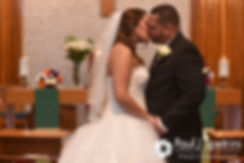 Stephanie and Henry share their first kiss during their October 2016 wedding ceremony at the Historic St. Joseph Church in Cumberland, Rhode Island.