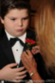 The ring bearer gets his flower pinned during Cathy and Ron's December 2015 wedding at Quidnessett Country Club in North Kingstown, Rhode Island.