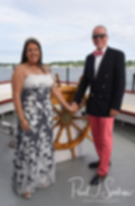 Mike & Kate pose for a formal photo following their May 2018 wedding ceremony aboard the Schooner Aurora boat in the waters off Newport, Rhode Island.