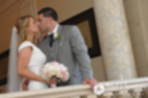 Amy and DJ kiss during a formal photo session at their June 2016 wedding reception at Aldrich Mansion in Warwick, Rhode Island.