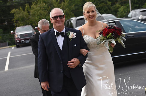 Meghan and her father get ready to walk into the church prior to her September 2018 wedding ceremony at Immaculate Conception Church in Cranston, Rhode Island.