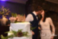 Stacey & Mack kiss after cutting their wedding cake during their December 2018 wedding reception at Independence Harbor in Assonet, Massachusetts.