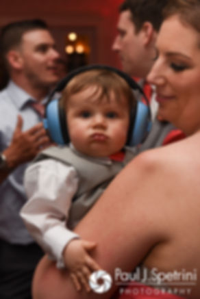 Michelle's nephew wears headphones to protect his ears during Michelle and Eric's May 2016 wedding at Hillside Country Club in Rehoboth, Massachusetts.