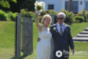 Bob and Debbie welcome guests to a receiving line following their June 2016 wedding in Barrington, Rhode Island.