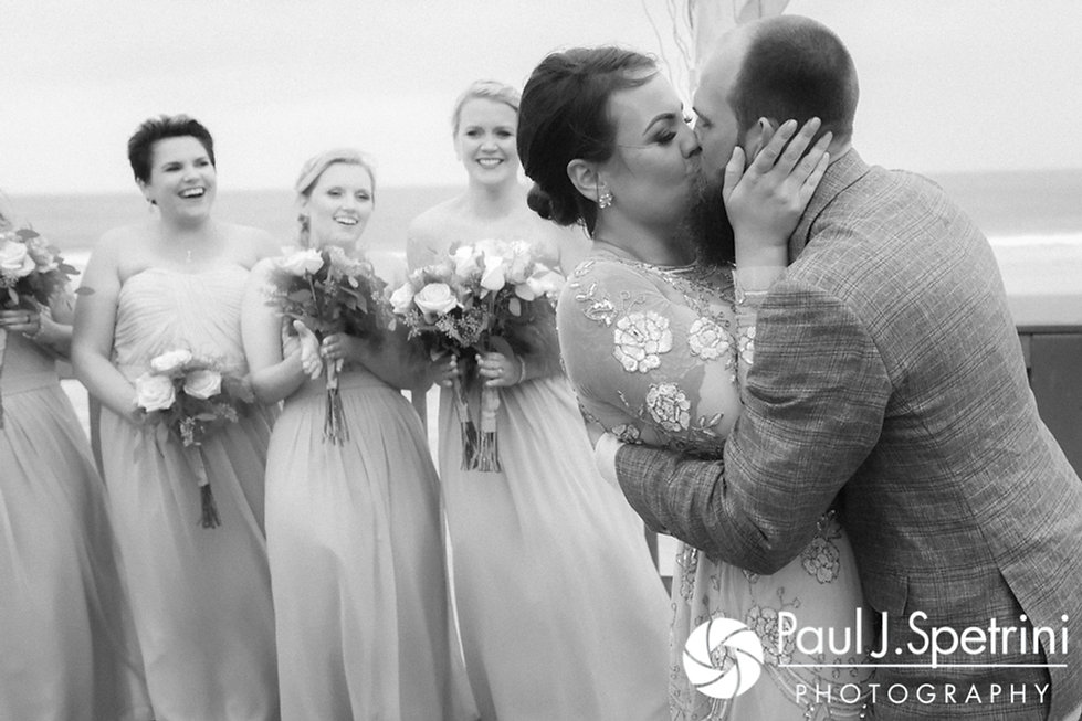 Arielle and Gary share their first kiss during their September 2017 wedding ceremony at North Beach Club House in Narragansett, Rhode Island.