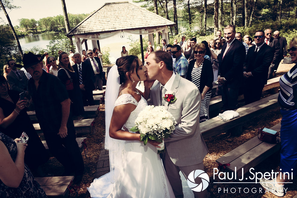 Heather and John share a kiss during their July 2016 wedding ceremony at Crystal Lake Golf Club in Burrillville, Rhode Island.
