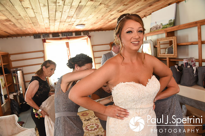Jennifer has help putting her dress on prior to her September 2017 wedding ceremony at Allen Hill Farm in Brooklyn, Connecticut.
